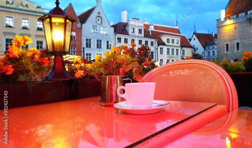фотография City Street cafe  restaurant table top with cup of coffe  blurred  light reflec