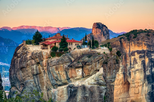 Foto op Plexiglas Cappuccino Landscape with monasteries and rock formations in Meteora, Greece. during the sunrise
