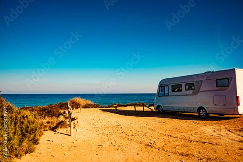 Fototapeta Camper car on beach, camping on nature
