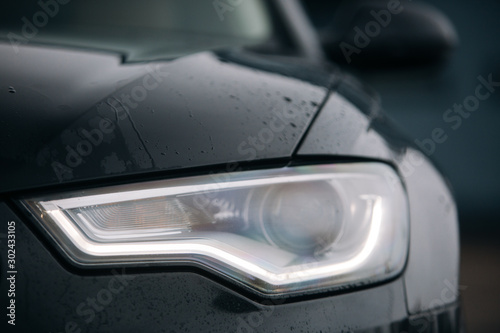 Fototapeta Led headlight of modern car at the rainy day obraz