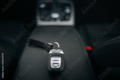 Photo Car ignition key at the armrest