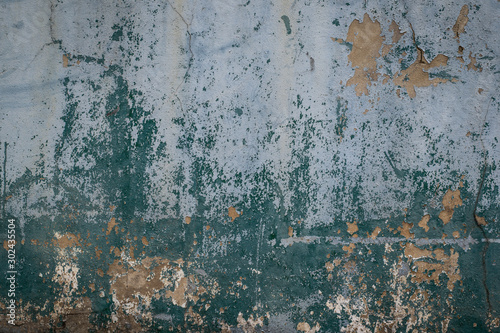 Obraz na plátně  Old and worn out wall background with paint peeling off , Grunge texture of buil