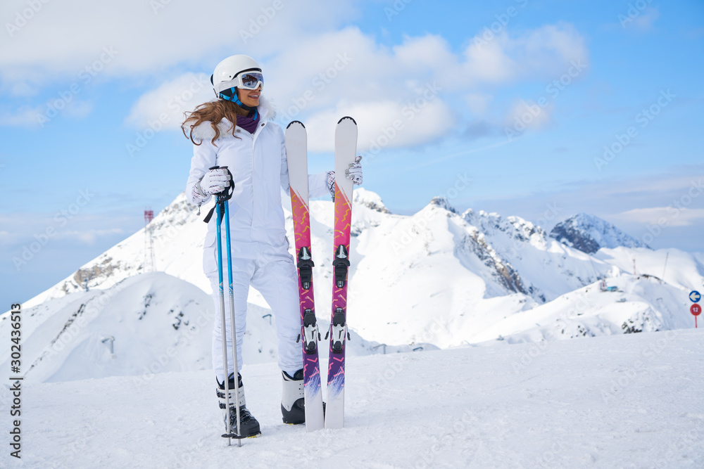 Fototapety, obrazy: woman skier  wearing white healmet with mask in snow winter mountain