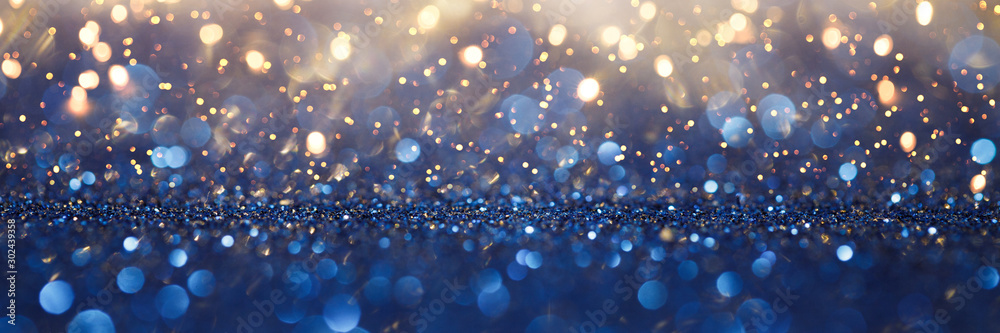 Fototapeta Vintage lights background. Gold lights and blue glitter. defocused