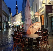 Autumn Rainy Evening In Old Town Of Tallinn, Estonia, Travel To Europe, Pink Umbrella And City Light Reflection On Pavement  People Walking On The Street City Lifestyle Travel To Europe  Street Cafe