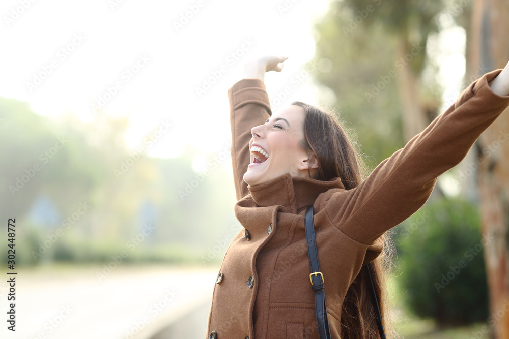 Fototapety, obrazy: Excited woman celebrating success in winter