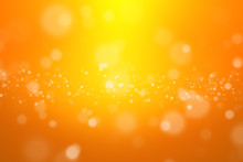 Bokeh Abstract Blurred Orange And Yellow Beautiful Background. Soft Color Light Glitter Sparkles. Element For Backdrop Or Design Cosmetic Ads, Happy New Year, Halloween, Beauty, Summer, Christmas