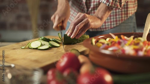 Fotografie, Obraz Woman slicing fresh healthy vegetables in the kitchen