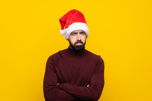 Man With Christmas Hat Over Isolated Yellow Background Feeling Upset