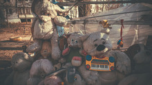 Old And Battered Soft Toys Lie On The Street. The Dump Of The Abandoned Toys