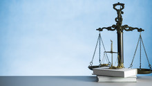 Law Scales On Wooden Desk Conc...