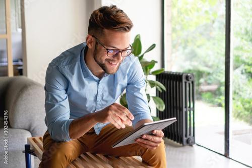 Fototapeta Young Man holding digital tablet obraz na płótnie