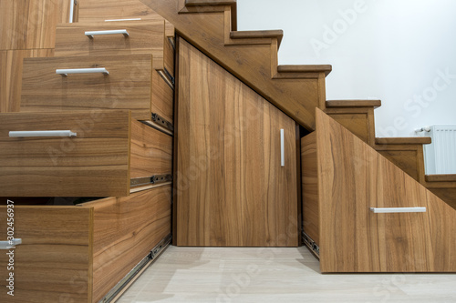Obraz na plátně Modern architecture interior with luxury hallway with glossy wooden stairs in multi-storey house