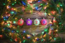 Cozy Winter Picture With Christmas Tree Branches, Lights And Balls With 2020
