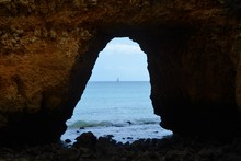 The Ocean Seen Through A Hole In The Rock
