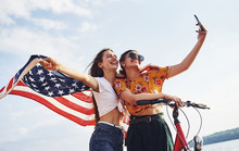 Two Patriotic Cheerful Women W...