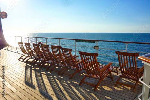 Empty deck chairs on Luxurious transatlantic crossing aboard the luxury ocean li Wallpaper Mural