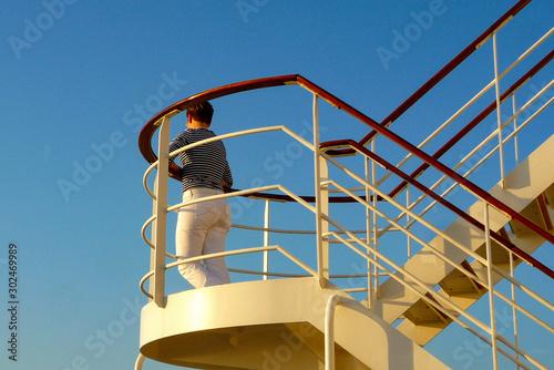 Woman day dreaming on luxurious transatlantic crossing aboard the luxury ocean l Wallpaper Mural