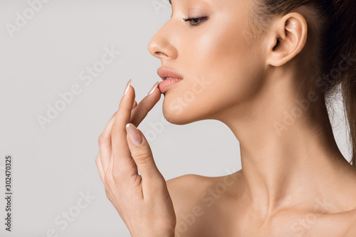 Obraz Lip augmentation. Beautiful girl touching her lips - fototapety do salonu