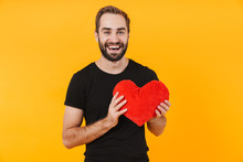 Image Of Attractive Man Wearing T-shirt Smiling And Holding Red Paper Heart