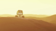 Mars Rover Drives Over Hill To...