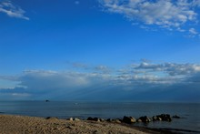 Sea Scape And Blue Sky With Sun Rays