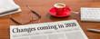 Leinwanddruck Bild - A newspaper on a wooden desk - Changes coming in 2020