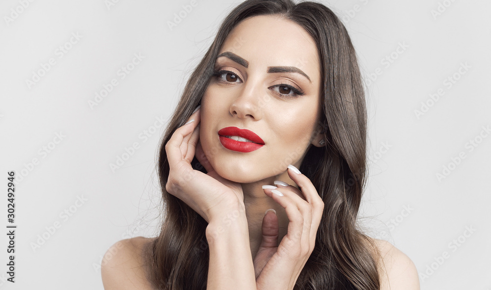 Fototapeta Portrait of brown hair cute woman with red lips touching her soft skin isolated white background