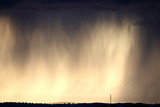 Series of photographs taken during a storm with heavy rain blurring the clouds and the landscape,