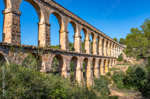Fotografiet Ancient roman aqueduct Ponte del Diable or Devil's Bridge in Tarragona, Spain