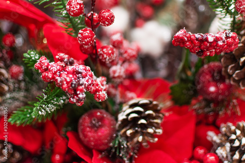 Obraz Fake plant of pine needles, pine cone and red berries for Christmas home decoration. - fototapety do salonu