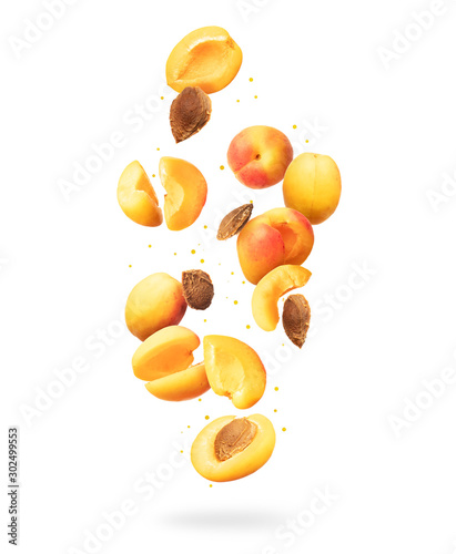 Fresh whole and sliced fresh apricots in the air on a white background Canvas Print