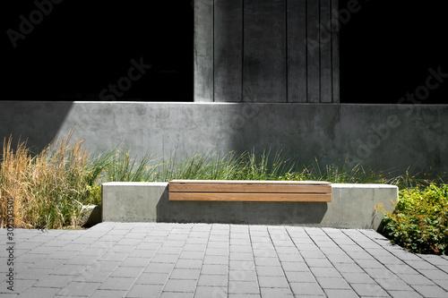 Fotografija Park bench in a modern design courtyard