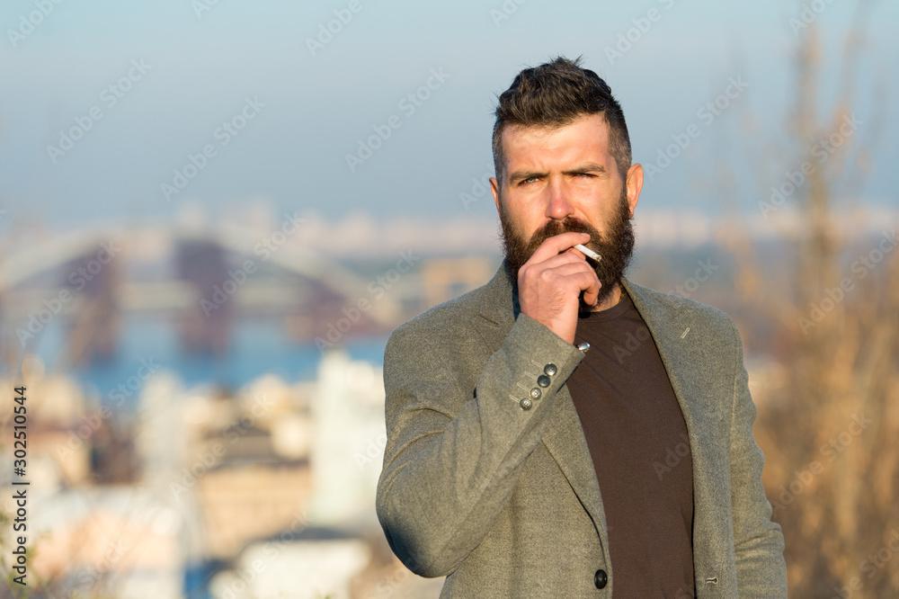 Fototapety, obrazy: Smoking habit or addiction. Smoking addict or smoker. Bearded man smoke cigarette. Hipster enjoy smoking break outdoor. Smoking tobacco