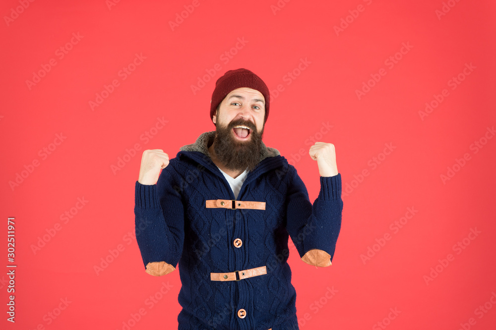 Fototapeta Success. Emotional expression. Casual clothes for winter season. Hipster with long beard. Hipster lifestyle. Stylish outfit hat accessory. Man bearded hipster stylish fashionable jumper and hat