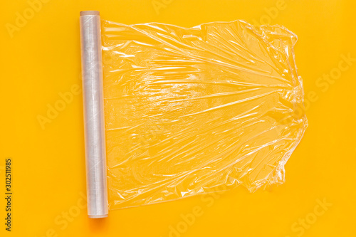 Roll of transparent polyethylene food stretch film for packing products in kitchen Fototapet