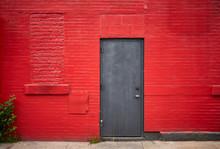 Steel Door In An Old Red Brick...