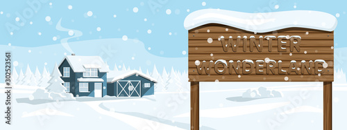 House in a snowy forest with wooden signboard