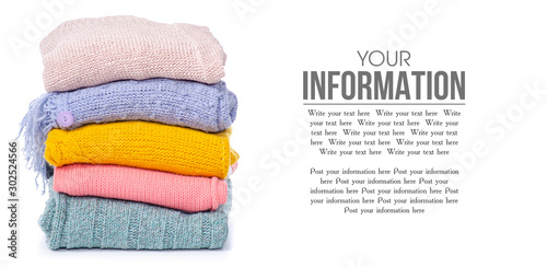 Obraz Stack color sweaters on white background isolation, space for text - fototapety do salonu