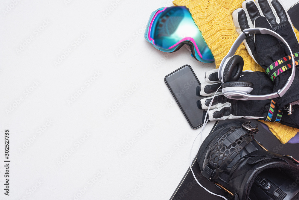 Fototapety, obrazy: Snowboarding concept flat lay background with copy space. Snowboard accessory on white background.