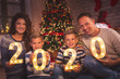 canvas print picture Family holding illuminative numbers 2020