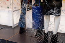 Shattered Window Of Broken Storefront Store Crack From Impact On Shop Glass Boutique