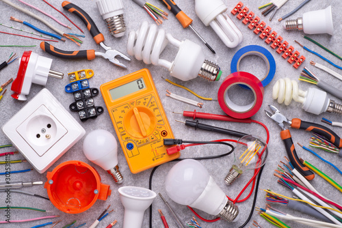 Photo Electrician equipment on silver, metalic background, top view