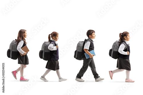Fotografia Schoolchildren in uniforms walking in line
