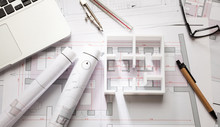 Construction Concept. Residential Building Drawings And House Model,