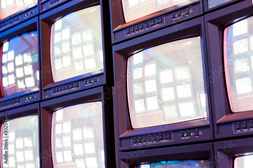 Fototapeta  Stack of old analog television monitor with live signal program in broadcasting