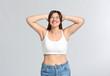 Leinwandbild Motiv Young body positive woman on grey background