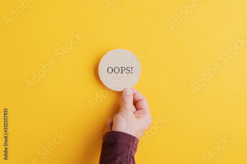 Oops sign on wooden cut circle Wallpaper Mural