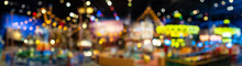 Beautiful Blurry And Defocused Multicolored Lights Of The Carousel In The Night Park. Panorama.