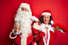 Couple Wearing Santa Costume H...